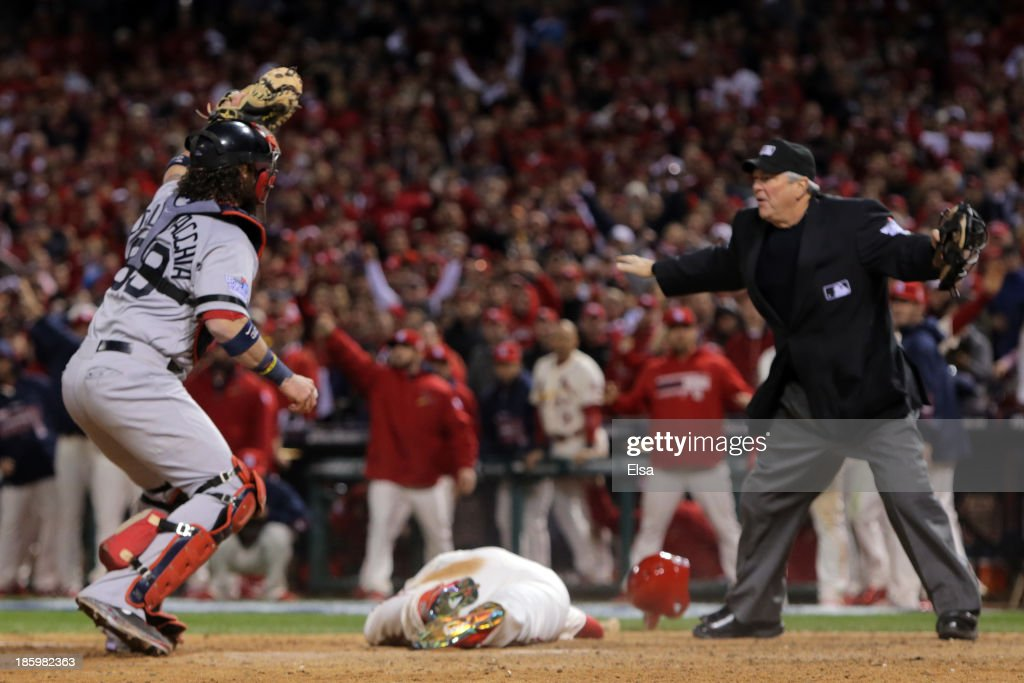 <a gi-track='captionPersonalityLinkClicked' href=/galleries/search?phrase=Jarrod+Saltalamacchia&family=editorial&specificpeople=836404 ng-click='$event.stopPropagation()'>Jarrod Saltalamacchia</a> #39 of the Boston Red Sox reacts as Home Plate Umpire Dana DeMuth #32 calls <a gi-track='captionPersonalityLinkClicked' href=/galleries/search?phrase=Allen+Craig&family=editorial&specificpeople=4405049 ng-click='$event.stopPropagation()'>Allen Craig</a> #21 of the St. Louis Cardinals safe at home in the ninth inning against the St. Louis Cardinals during Game Three of the 2013 World Series at Busch Stadium on October 26, 2013 in St Louis, Missouri.
