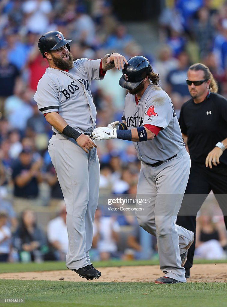 <a gi-track='captionPersonalityLinkClicked' href=/galleries/search?phrase=Jarrod+Saltalamacchia&family=editorial&specificpeople=836404 ng-click='$event.stopPropagation()'>Jarrod Saltalamacchia</a> #39 of the Boston Red Sox, right, celebrates his two-run home run against Chris Withrow #44 of the Los Angeles Dodgers (not in photo) with teammate <a gi-track='captionPersonalityLinkClicked' href=/galleries/search?phrase=Mike+Napoli&family=editorial&specificpeople=525007 ng-click='$event.stopPropagation()'>Mike Napoli</a> #12 at home plate in the sixth inning during the MLB game at Dodger Stadium on August 25, 2013 in Los Angeles, California. The Red Sox defeated the Dodgers 8-1.