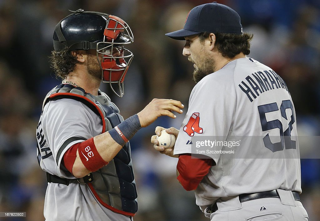 Jarrod Saltalamacchia of the Boston Red Sox talks to Joel Hanrahan during MLB game action against the Toronto Blue Jays on April 30 2013 at Rogers...