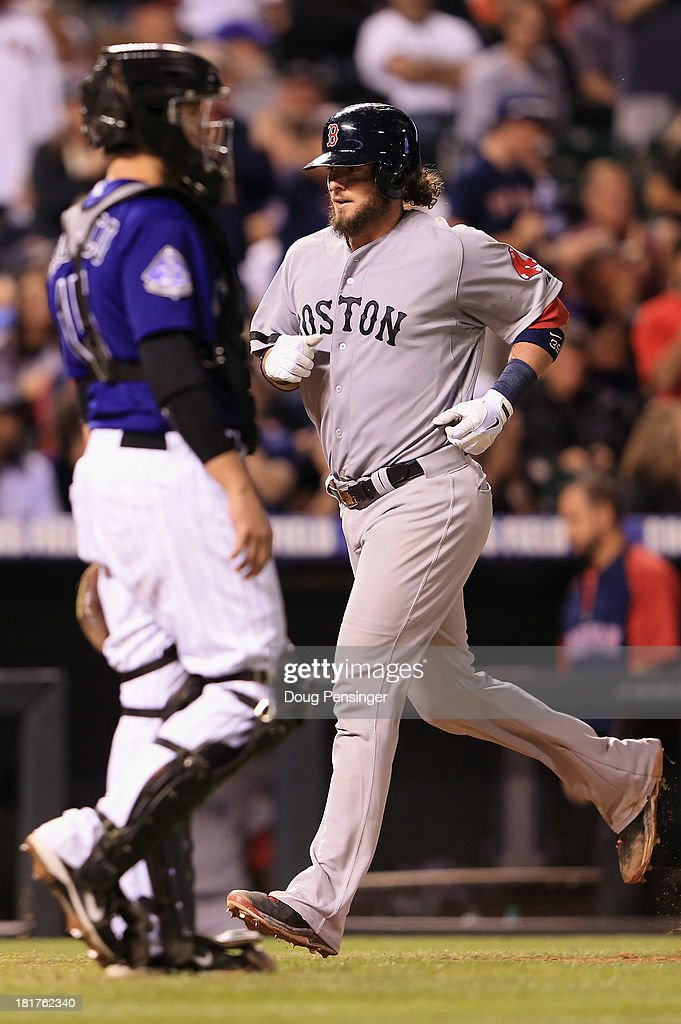 <a gi-track='captionPersonalityLinkClicked' href=/galleries/search?phrase=Jarrod+Saltalamacchia&family=editorial&specificpeople=836404 ng-click='$event.stopPropagation()'>Jarrod Saltalamacchia</a> #39 of the Boston Red Sox trots home past catcher <a gi-track='captionPersonalityLinkClicked' href=/galleries/search?phrase=Jordan+Pacheco&family=editorial&specificpeople=6889136 ng-click='$event.stopPropagation()'>Jordan Pacheco</a> #15 of the Colorado Rockies on his two run home run off of Josh Outman #88 of the Colorado Rockies in the ninth inning at Coors Field on September 24, 2013 in Denver, Colorado. The Rockies defeated the Red Sox 8-3.