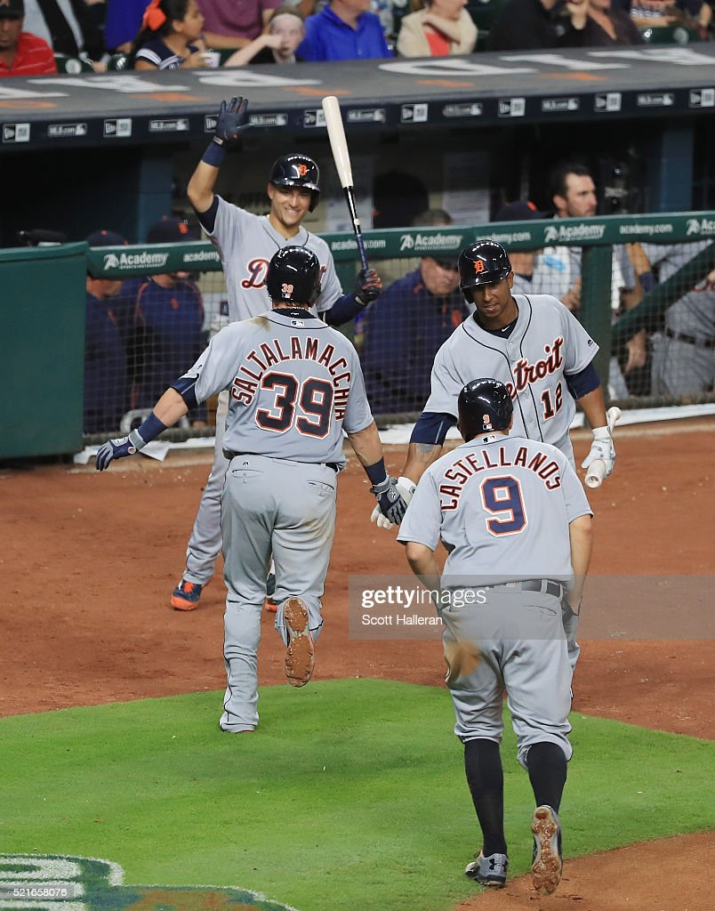 Jarrod Saltalamacchia of the Detroit Tigers is greeted by teammates after Saltalamacchia hit a tworun home run in the sixth inning of their game...
