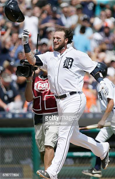 Jarrod Saltalamacchia of the Detroit Tigers throws up his helmet while celebrating his walkoff home run in the ninth inning to defeat the Kansas City...