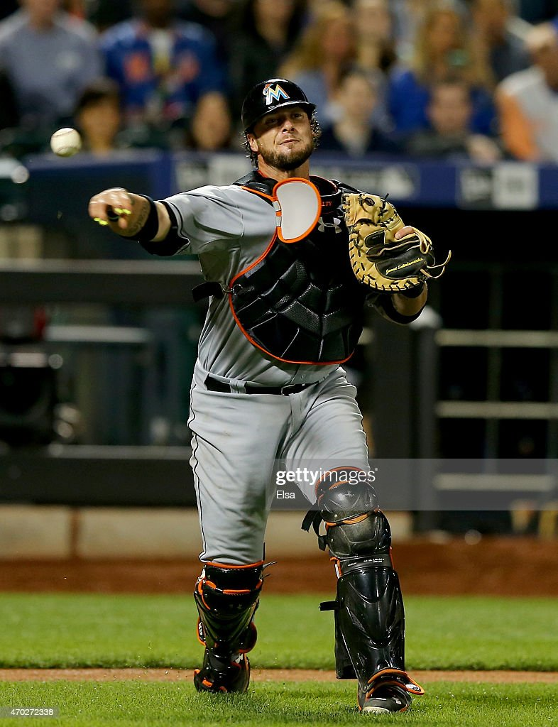 Jarrod Saltalamacchia #39 of the Miami Marlins fields a hit by Travis d'Arnaud of the New York Mets and sends it to first for the out in the fifth inning on April 18, 2015 at Citi Field in the Flushing neighborhood of the Queens borough of New York City.