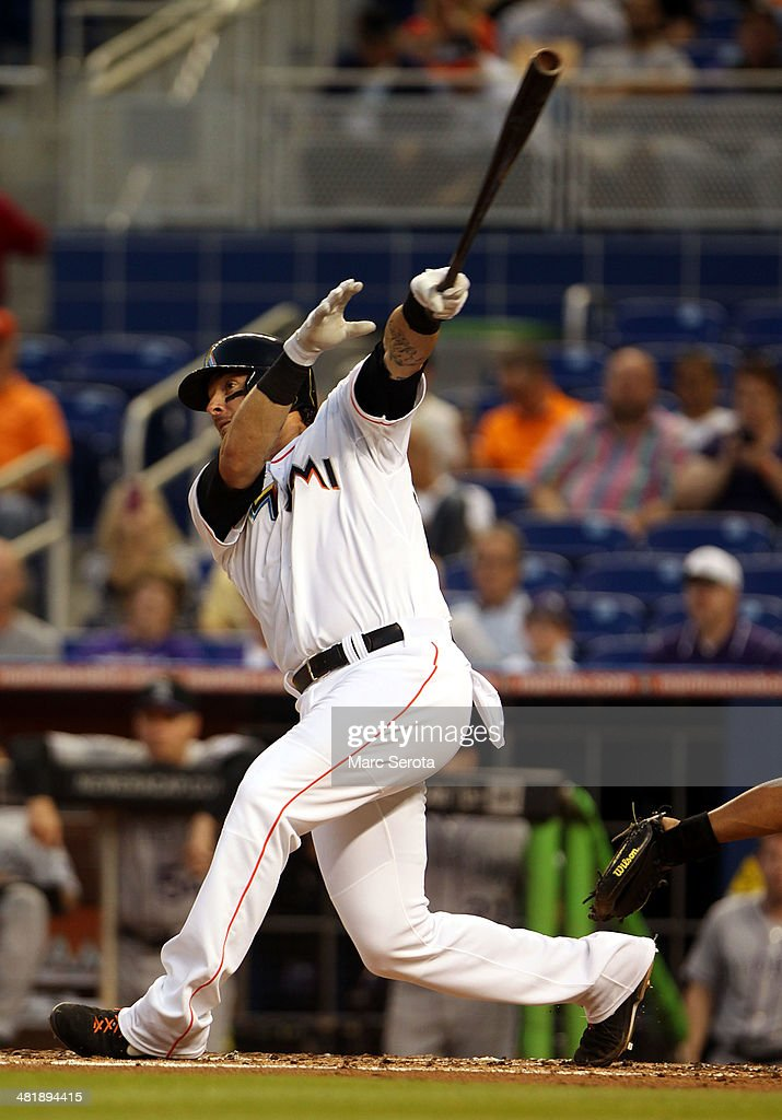 Jarrod Saltalamacchia #39 of the Miami Marlins hits an RBI single against the Colorado Rockies during the third inning at the Marlins Park on April 1, 2014 in Miami, Florida.