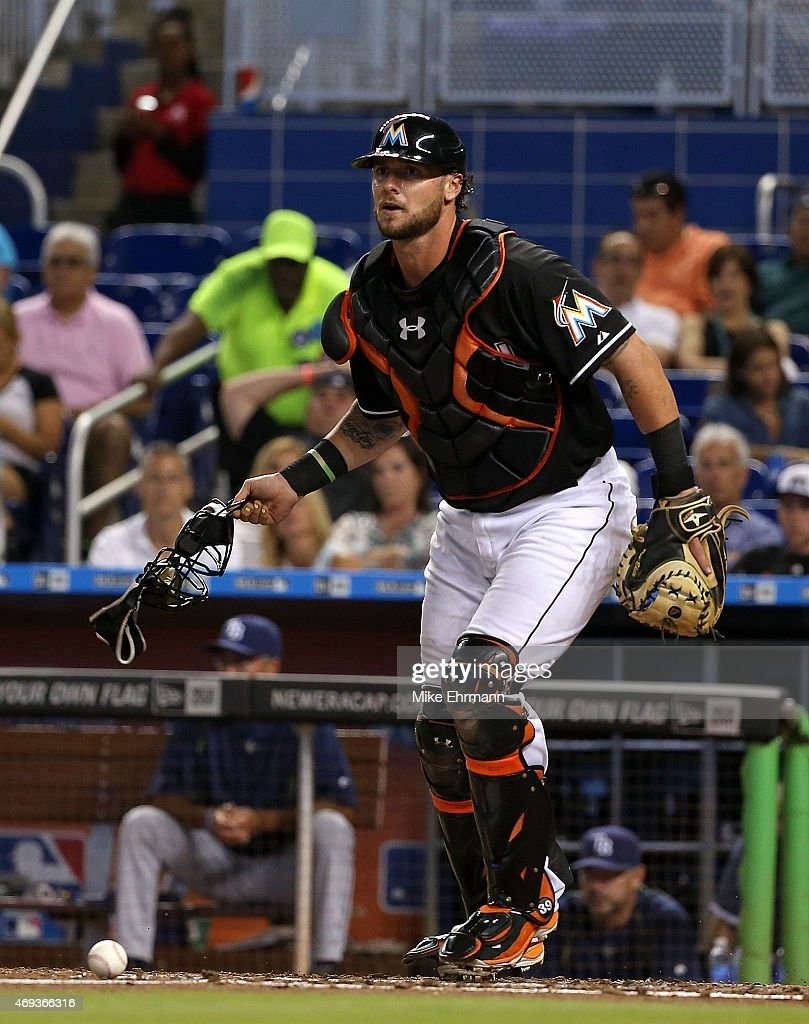 Jarrod Saltalamacchia #39 of the Miami Marlins watches the runner at third during a game against the Tampa Bay Rays at Marlins Park on April 11, 2015 in Miami, Florida.