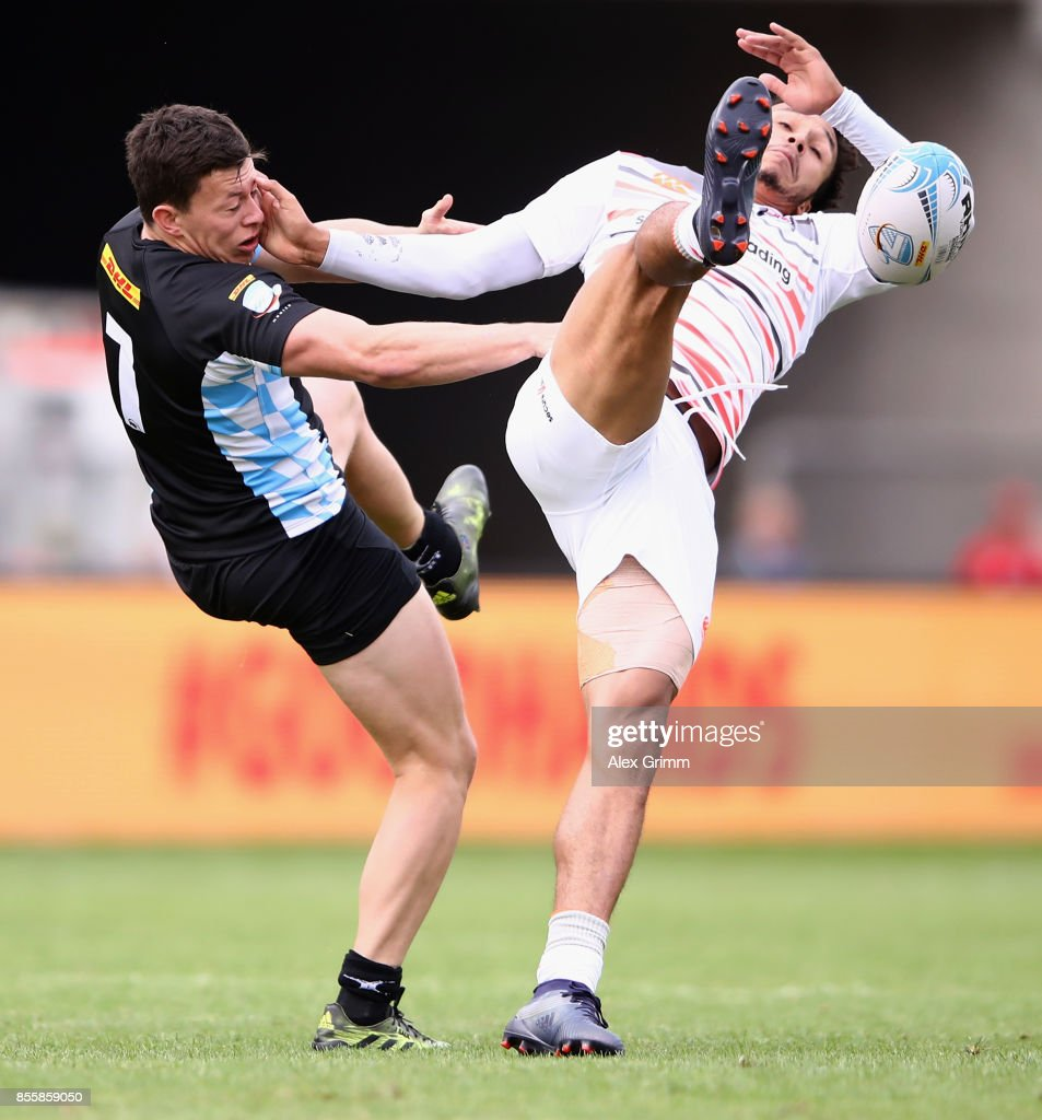 Jarrod Saul (L) and Ryan Olowofela of England battle for the ball during the quarter-final match between Germany and England on Day 2 of the Rugby Oktoberfest 7s tournament at Olympiastadion on September 30, 2017 in Munich, Germany.