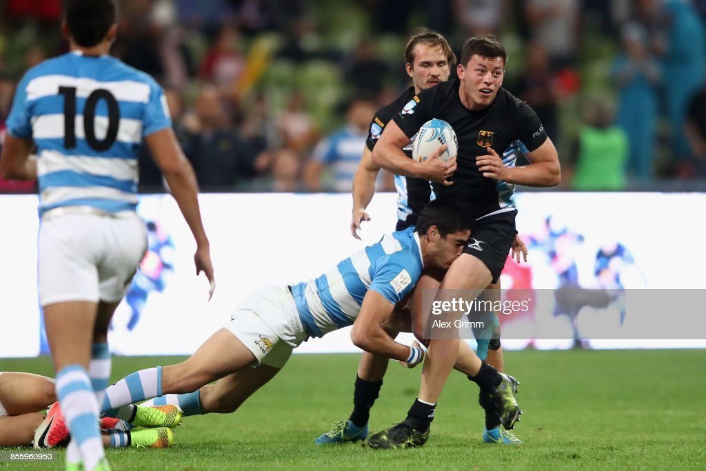 Jarrod Saul of Germany is tackled by Marcos Moroni of Argentina during the 5th place match between Argentina and Germany on Day 2 of the Rugby Oktoberfest 7s tournament at Olympiastadion on September 30, 2017 in Munich, Germany.