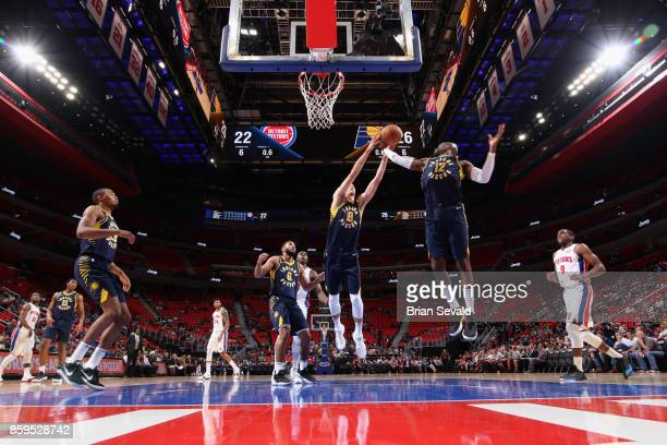 Jarrod Uthoff and Damien Wilkins of the Indiana Pacers jumps for the rebound against the Detroit Pistons on October 9 2017 at Little Caesars Arena in...