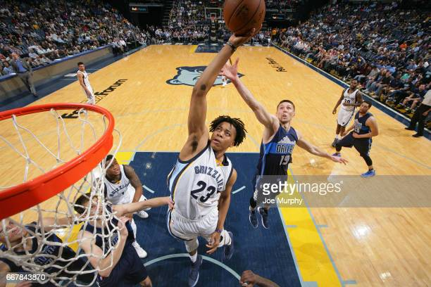 Jarrod Uthoff of the Dallas Mavericks and Deyonta Davis of the Memphis Grizzlies go up for a rebound on April 12 2017 at FedEx Forum in Memphis...