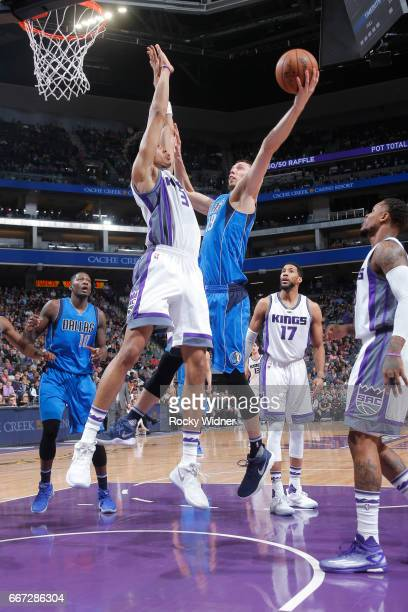 Jarrod Uthoff of the Dallas Mavericks goes up for the shot against Skal Labissiere of the Sacramento Kings on April 4 2017 at Golden 1 Center in...