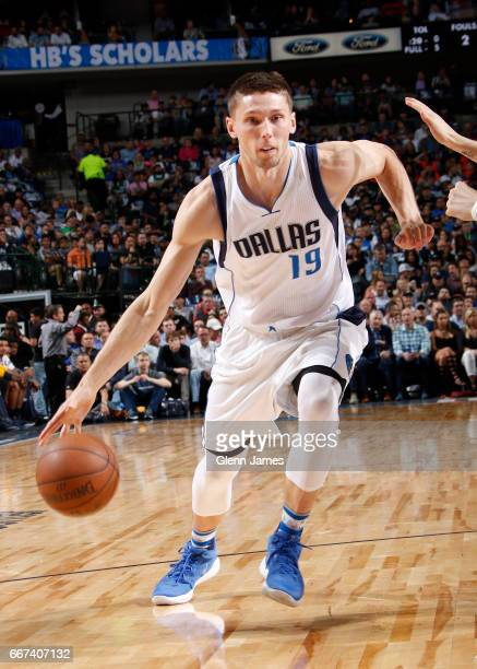 Jarrod Uthoff of the Dallas Mavericks handles the ball against the Denver Nuggets during the game on April 11 2017 at the American Airlines Center in...