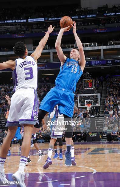 Jarrod Uthoff of the Dallas Mavericks shoots against Skal Labissiere of the Sacramento Kings on April 4 2017 at Golden 1 Center in Sacramento...