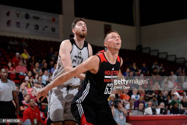 Jarrod Uthoff of the Houston Rockets boxes out against Ryan Kelly of the Atlanta Hawks during the 2017 Summer League on July 14 2017 at Cox Pavillion...