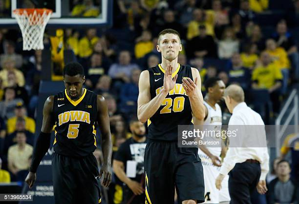 Jarrod Uthoff of the Iowa Hawkeyes celebrates as he heads to the bench with Anthony Clemmons of the Iowa Hawkeyes during the second half of a 7161...