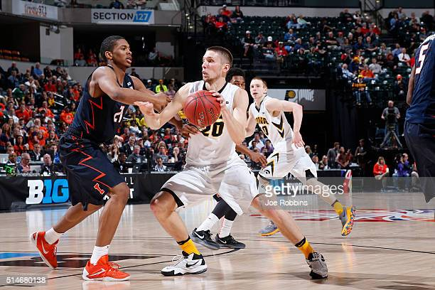 Jarrod Uthoff of the Iowa Hawkeyes drives against Malcolm Hill of the Illinois Fighting Illini in the second round of the Big Ten Basketball...