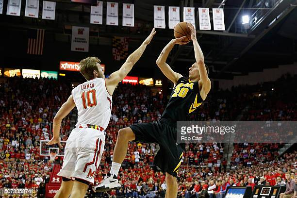 Jarrod Uthoff of the Iowa Hawkeyes puts up a shot over Jake Layman of the Maryland Terrapins in the first half at Xfinity Center on January 28 2016...