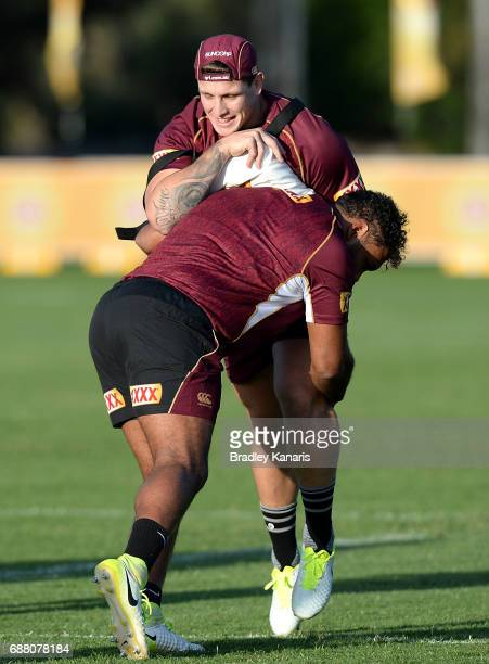 Jarrod Wallace and Sam Thaiday perform tackling drills during a Queensland Maroons State of Origin training session at InterContinental Sanctuary...