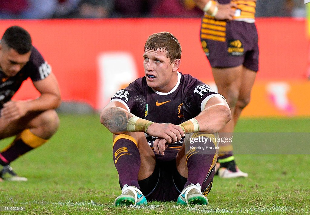 Jarrod Wallace of the Broncos looks dejected after his team loses the round 12 NRL match between the Brisbane Broncos and the Wests Tigers at Suncorp Stadium on May 27, 2016 in Brisbane, Australia.