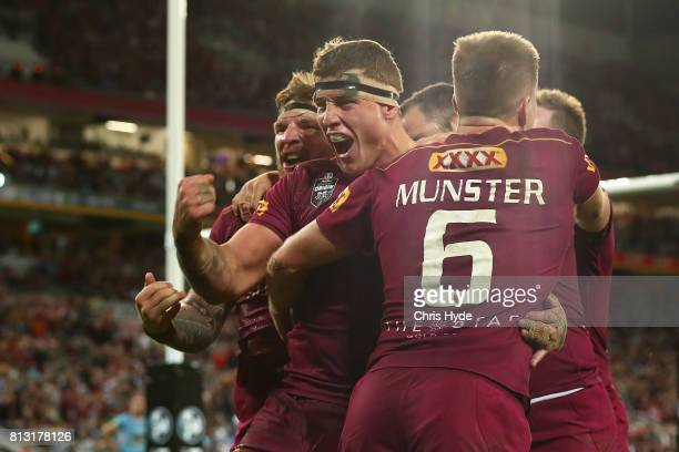 Jarrod Wallace of the Maroons celebrates a try during game three of the State Of Origin series between the Queensland Maroons and the New South Wales...