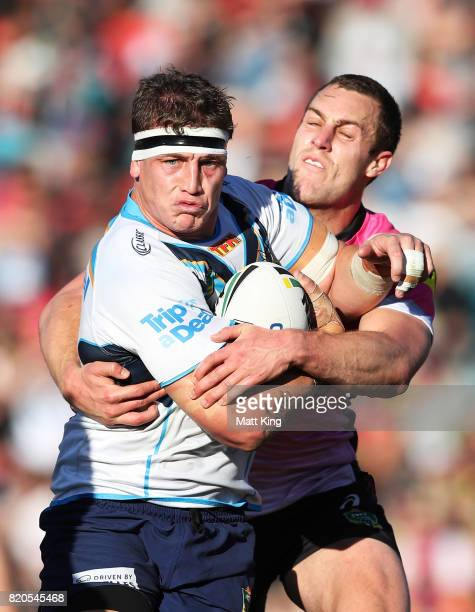 Jarrod Wallace of the Titans is tackled by Isaah Yeo of the Panthers during the round 20 NRL match between the Penrith Panthers and the Gold Coast...