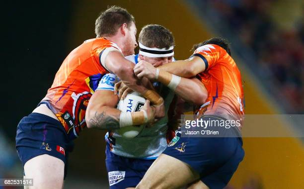 Jarrod Wallace of the Titans runs at the defence during the round 10 NRL match between the Melbourne Storm and the Gold Coast Titans at Suncorp...