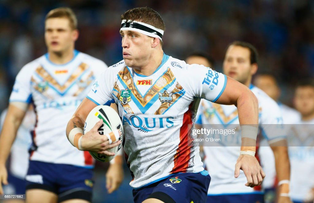 Jarrod Wallace of the Titans runs with the ball during the round 11 NRL match between the Gold Coast Titans and the Manly Sea Eagles at Cbus Super Stadium on May 20, 2017 in Gold Coast, Australia.