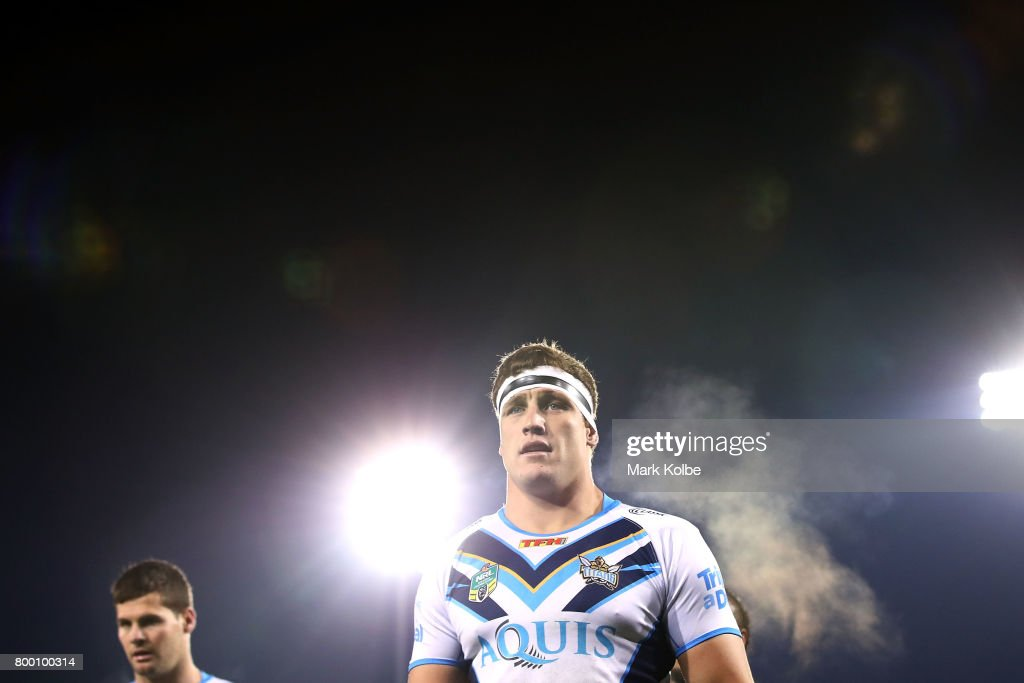 Jarrod Wallace of the Titans walks off the field after the warm-up before the round 16 NRL match between the Wests Tigers and the Gold Coast Titans at Campbelltown Sports Stadium on June 23, 2017 in Sydney, Australia.