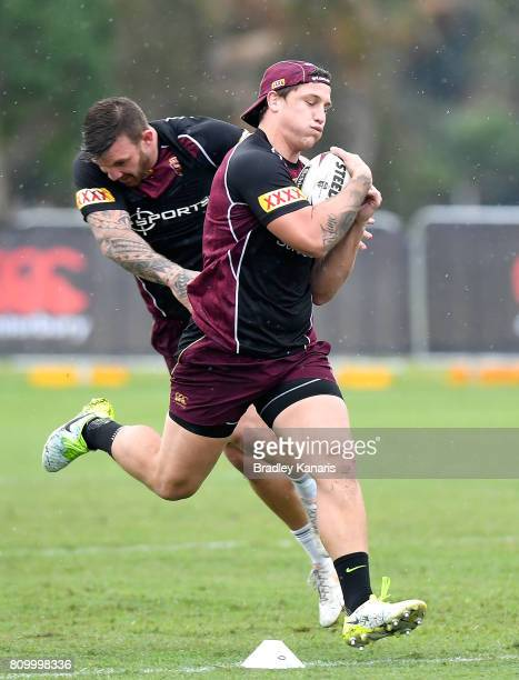 Jarrod Wallace runs with the ball during a Queensland Maroons State of Origin training session at Sanctuary Cove on July 7 2017 in Brisbane Australia