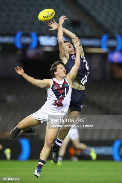 Jarrod Walters of the Geelong Falcons competes in the air with Lachie Harris of the Sandringham Dragons during the TAC Cup Grand Final match between...