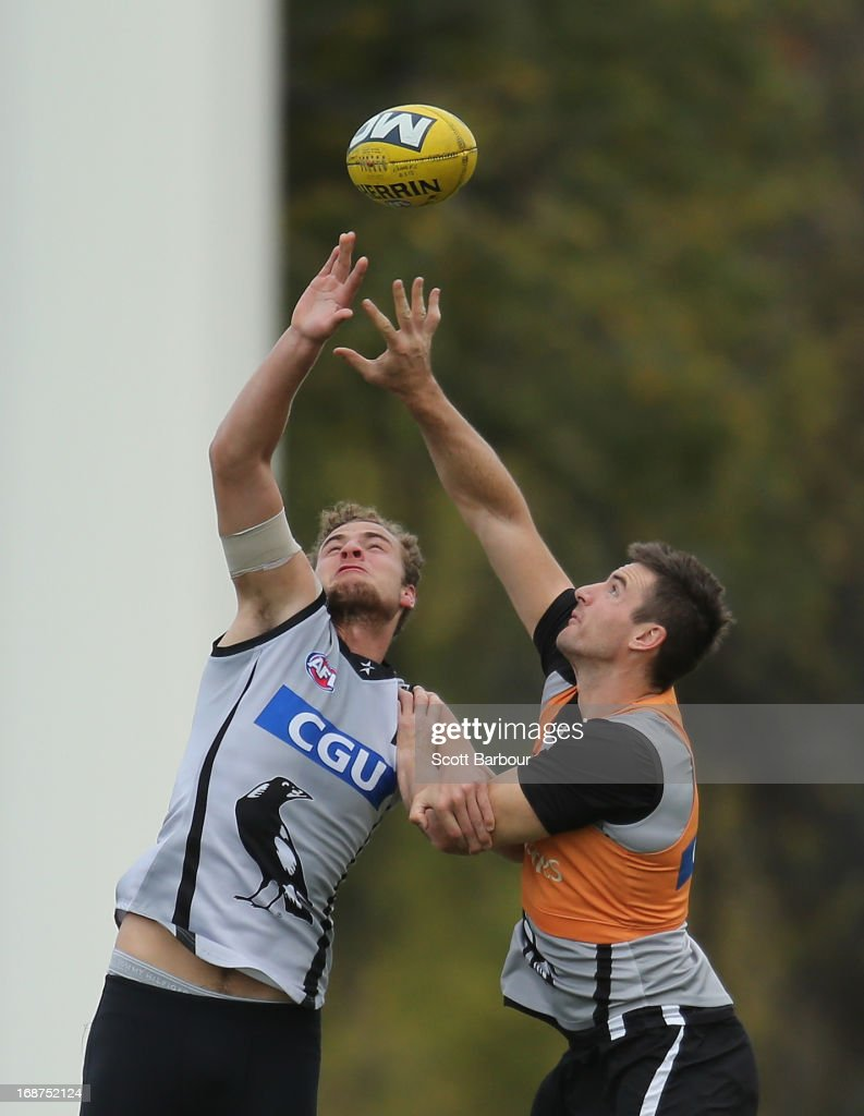 Jarrod Witts and Darren Jolly of the Magpies compete for the ball during a Collingwood Magpies AFL training session at Olympic Park on May 15, 2013 in Melbourne, Australia.
