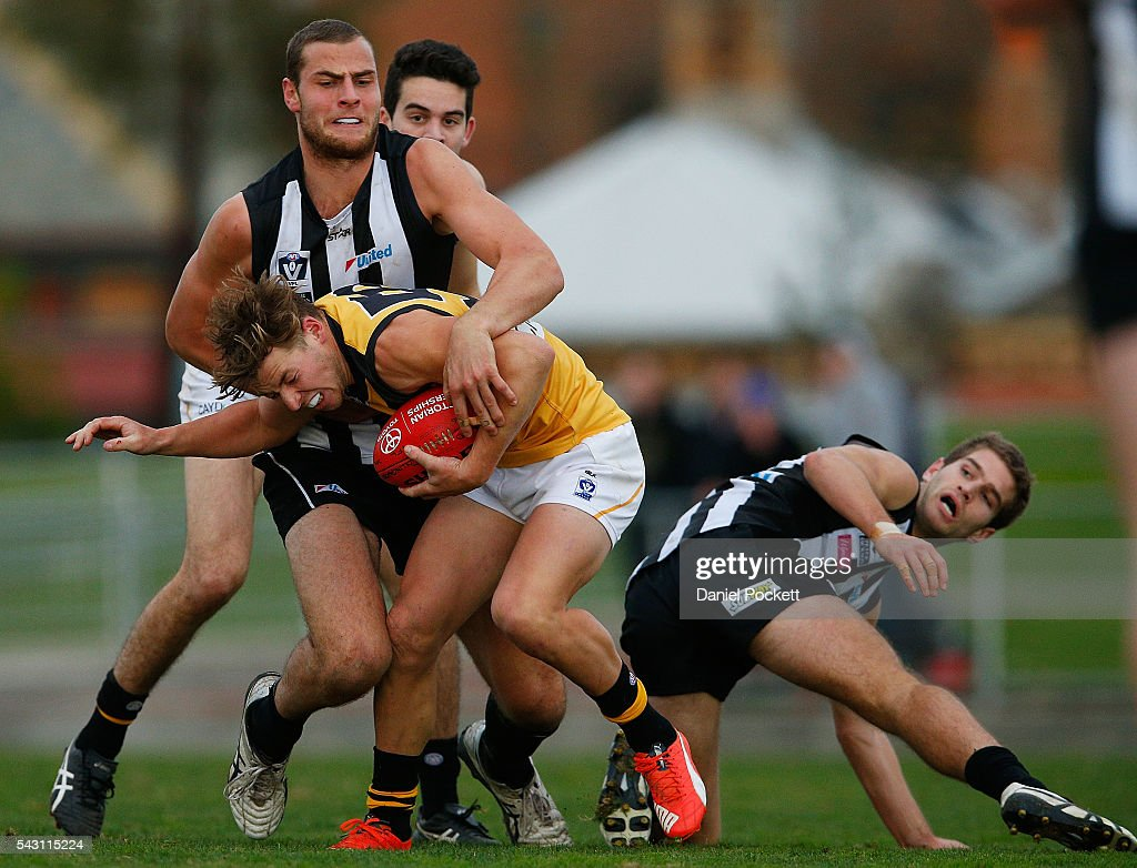 Jarrod Witts of the Magpies and Jake Aarts of the Tigers contest the ball during the round 12 VFL match between the Collingwood Magpies and the Richmond Tigers at Victoria Park on June 26, 2016 in Melbourne, Australia.