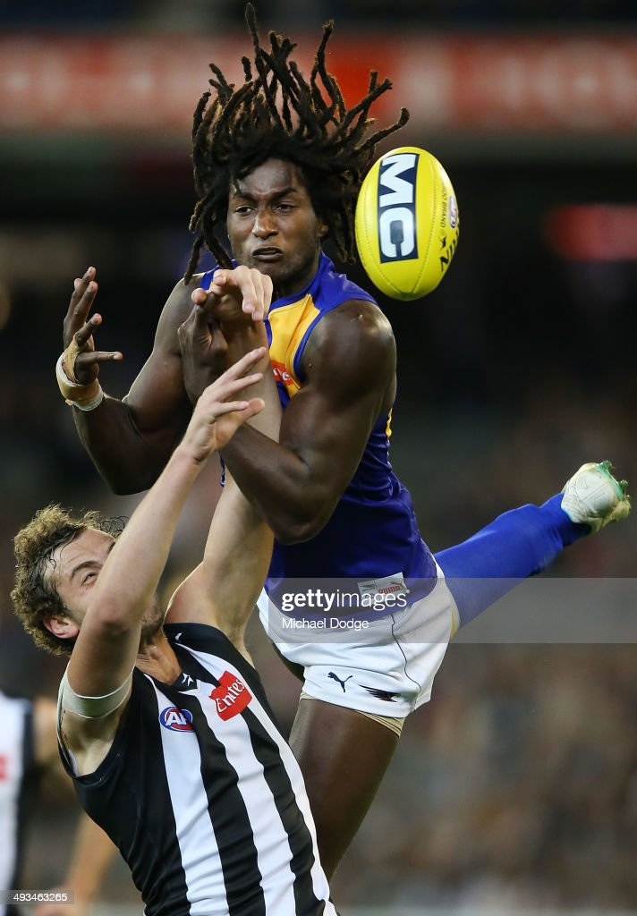 Jarrod Witts (L) of the Magpies and Nic Naitanui of the Eagles compete for the ball during the round 10 AFL match between the Collingwood Magpies and West Coast Eagles at Melbourne Cricket Ground on May 24, 2014 in Melbourne, Australia.