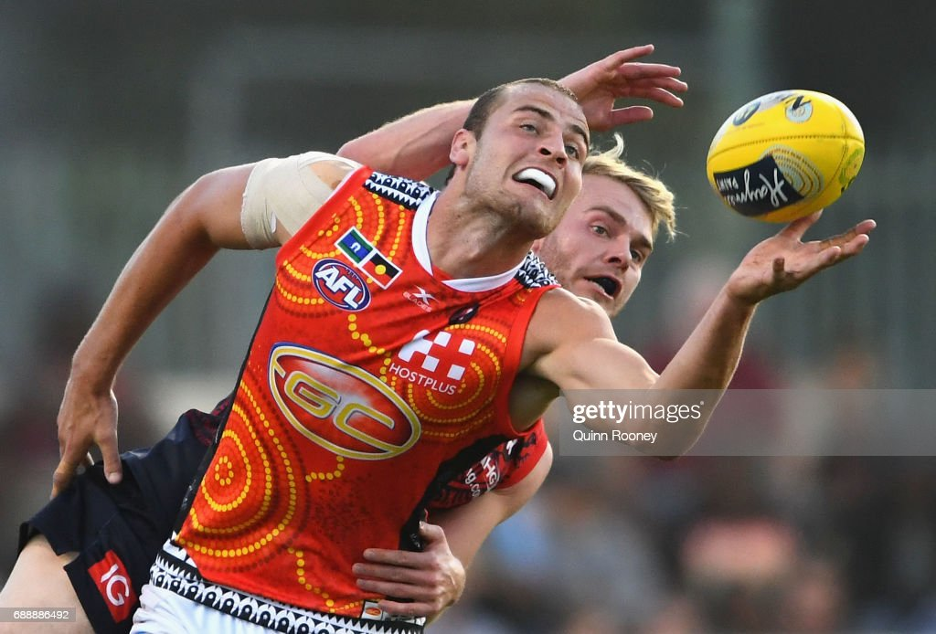 Jarrod Witts of the Suns and Jack Watts of the Demons compete in the ruck during the round ten AFL match between the Melbourne Demons and the Gold Coast Suns at Traeger Park on May 27, 2017 in Alice Springs, Australia.
