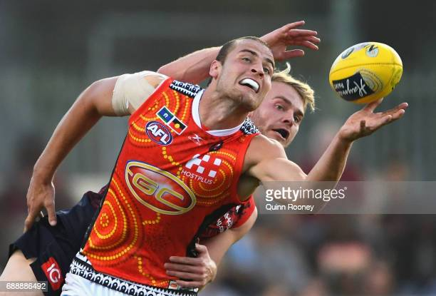 Jarrod Witts of the Suns and Jack Watts of the Demons compete in the ruck during the round ten AFL match between the Melbourne Demons and the Gold...
