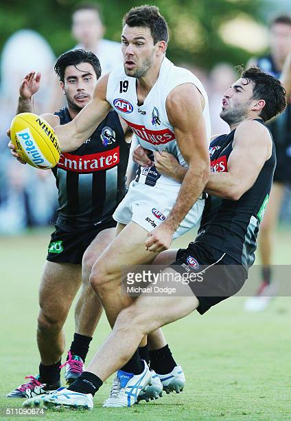 Jarryd Blair of the Magpies and Alex Fasolo of the Magpies tackle Levi Greenwood during the Collingwood Magpies AFL Intraclub match at Olympic Park...