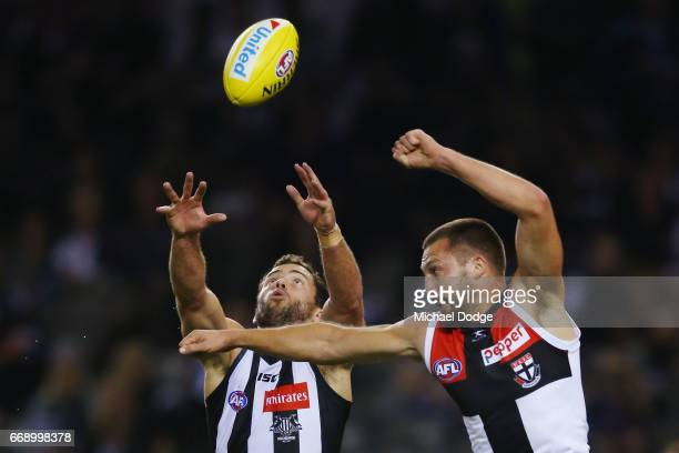 Jarryd Blair of the Magpies and Jarryn Geary of the Saints compete for the ball during the round four AFL match between the Collingwood Magpies and...