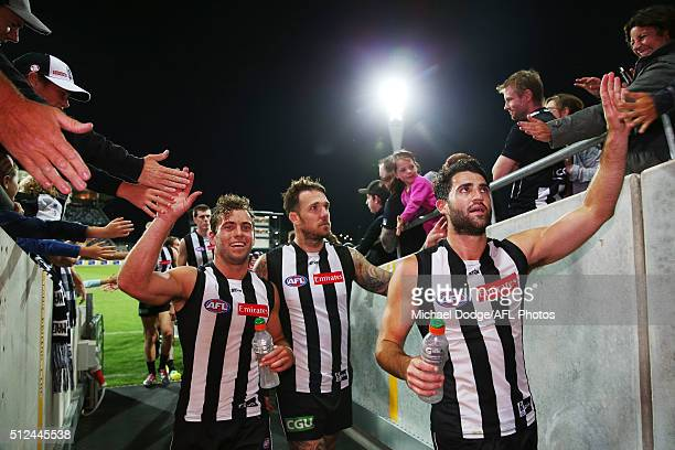 Jarryd Blair of the Magpies Dane Swan and Alex Fasolo of the Magpies celebrate the win with fans during the 2016 NAB Challenge match between the...