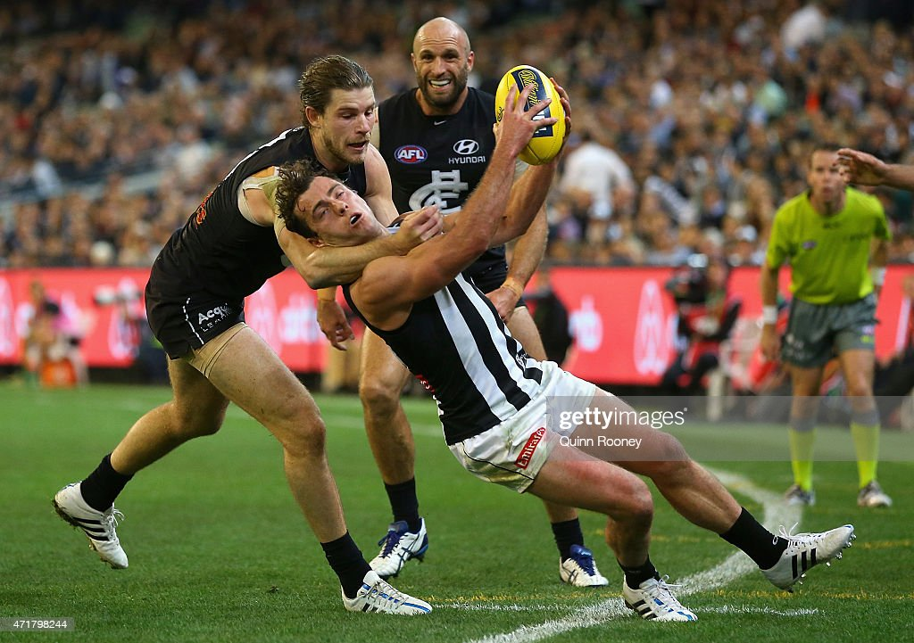 Jarryd Blair of the Magpies is tackled by Bryce Gibbs of the Blues during the round five AFL match between the Carlton Blues and the Collingwood Magpies at Melbourne Cricket Ground on May 1, 2015 in Melbourne, Australia.