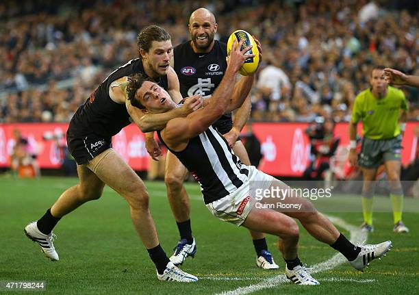 Jarryd Blair of the Magpies is tackled by Bryce Gibbs of the Blues during the round five AFL match between the Carlton Blues and the Collingwood...