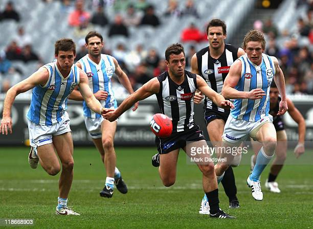 Jarryd Blair of the Magpies leads in the race for the ball during the round 16 AFL match between the Collingwood Mgapies and the North Melbourne...