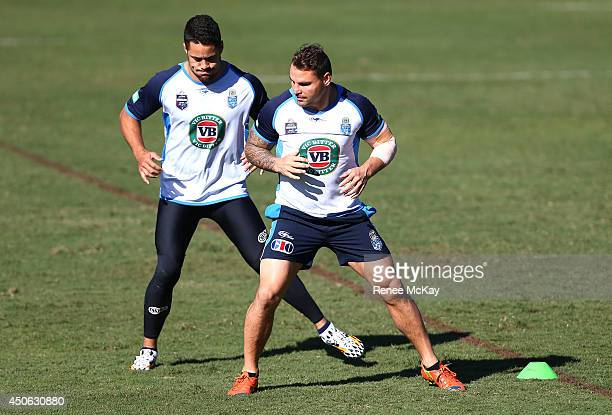 Jarryd Hayne and Anthony Watmough warm up during a New South Wales State of Origin training session at Novotel Coffs Harbour on June 15 2014 in Coffs...