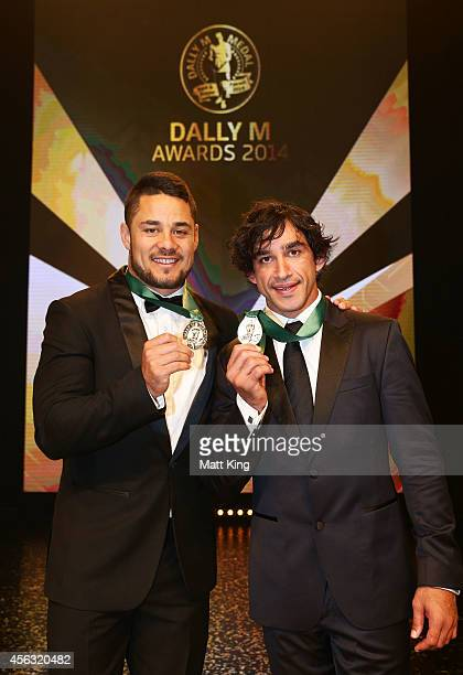 Jarryd Hayne and Johnathan Thurston pose after being presented as joint winners of the Dally M Medal at the Dally M Awards at Star City on September...