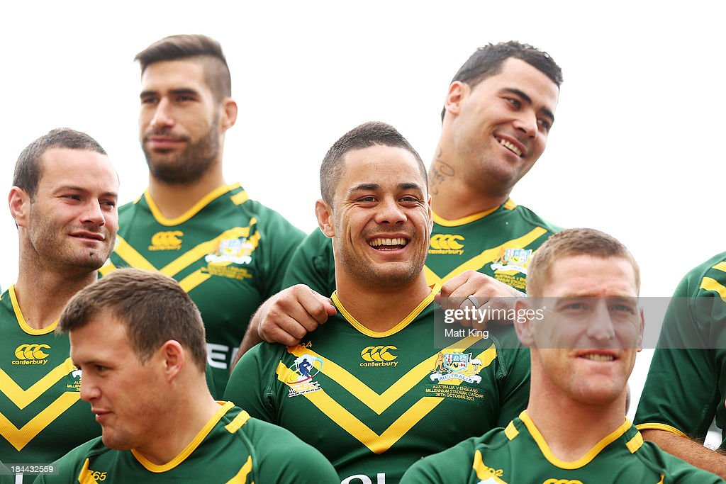 Jarryd Hayne interacts with other players during an Australian Kangaroos Rugby League World Cup teamphoto session at Crowne Plaza, Coogee on October 14, 2013 in Sydney, Australia.
