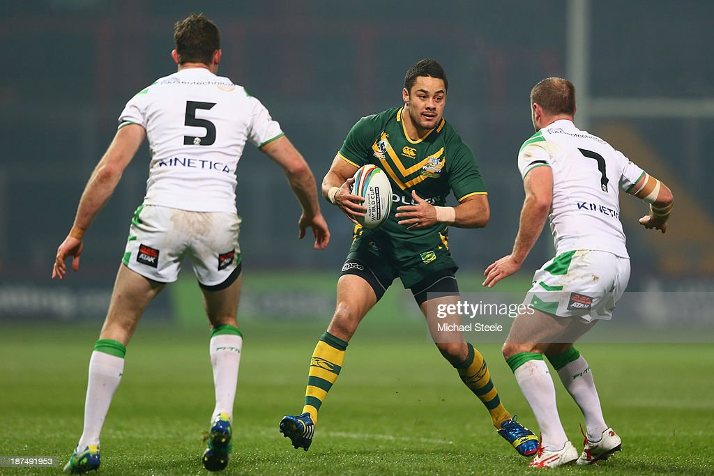 <a gi-track='captionPersonalityLinkClicked' href=/galleries/search?phrase=Jarryd+Hayne&family=editorial&specificpeople=563352 ng-click='$event.stopPropagation()'>Jarryd Hayne</a> of Australia runs at <a gi-track='captionPersonalityLinkClicked' href=/galleries/search?phrase=Pat+Richards&family=editorial&specificpeople=233418 ng-click='$event.stopPropagation()'>Pat Richards</a> (L) and <a gi-track='captionPersonalityLinkClicked' href=/galleries/search?phrase=Liam+Finn&family=editorial&specificpeople=2173238 ng-click='$event.stopPropagation()'>Liam Finn</a> (R) of Ireland during the Rugby League World Cup Group A match between Australia and Ireland at Thomond Park on November 9, 2013 in Limerick, .
