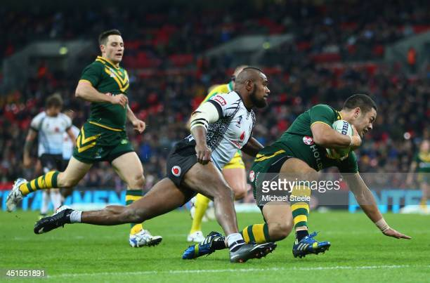 Jarryd Hayne of Australia scores a try as Marika Koroibete of Fiji fails to challenge during the Rugby League World Cup Semi Final match between...
