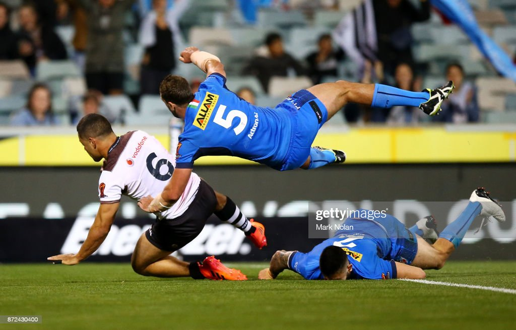 Jarryd Hayne of Fiji crashes over for a try that was later dis-allowed during the 2017 Rugby League World Cup match between Fiji and Italy at Canberra Stadium on November 10, 2017 in Canberra, Australia.