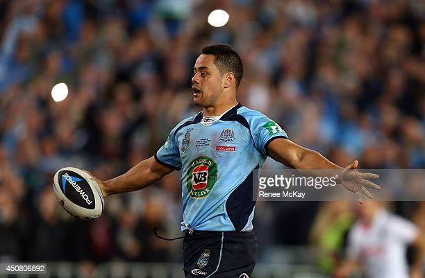 Jarryd Hayne of the Blues carries the ball over the line to end the game at game two of the State of Origin series between the New South Wales Blues...