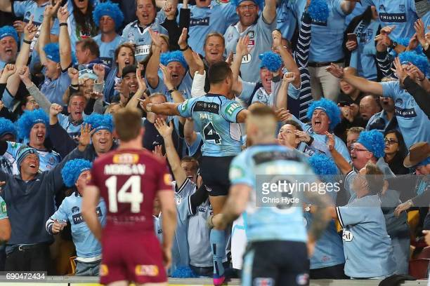 Jarryd Hayne of the Blues celebrates a try during game one of the State Of Origin series between the Queensland Maroons and the New South Wales Blues...