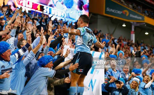 Jarryd Hayne of the Blues celebrates scoring a try during game one of the State Of Origin series between the Queensland Maroons and the New South...