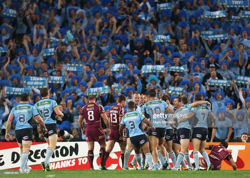 Jarryd Hayne of the Blues celebrates with teammates after scoring a try during game one of the ARL State of Origin series between the New South Wales...